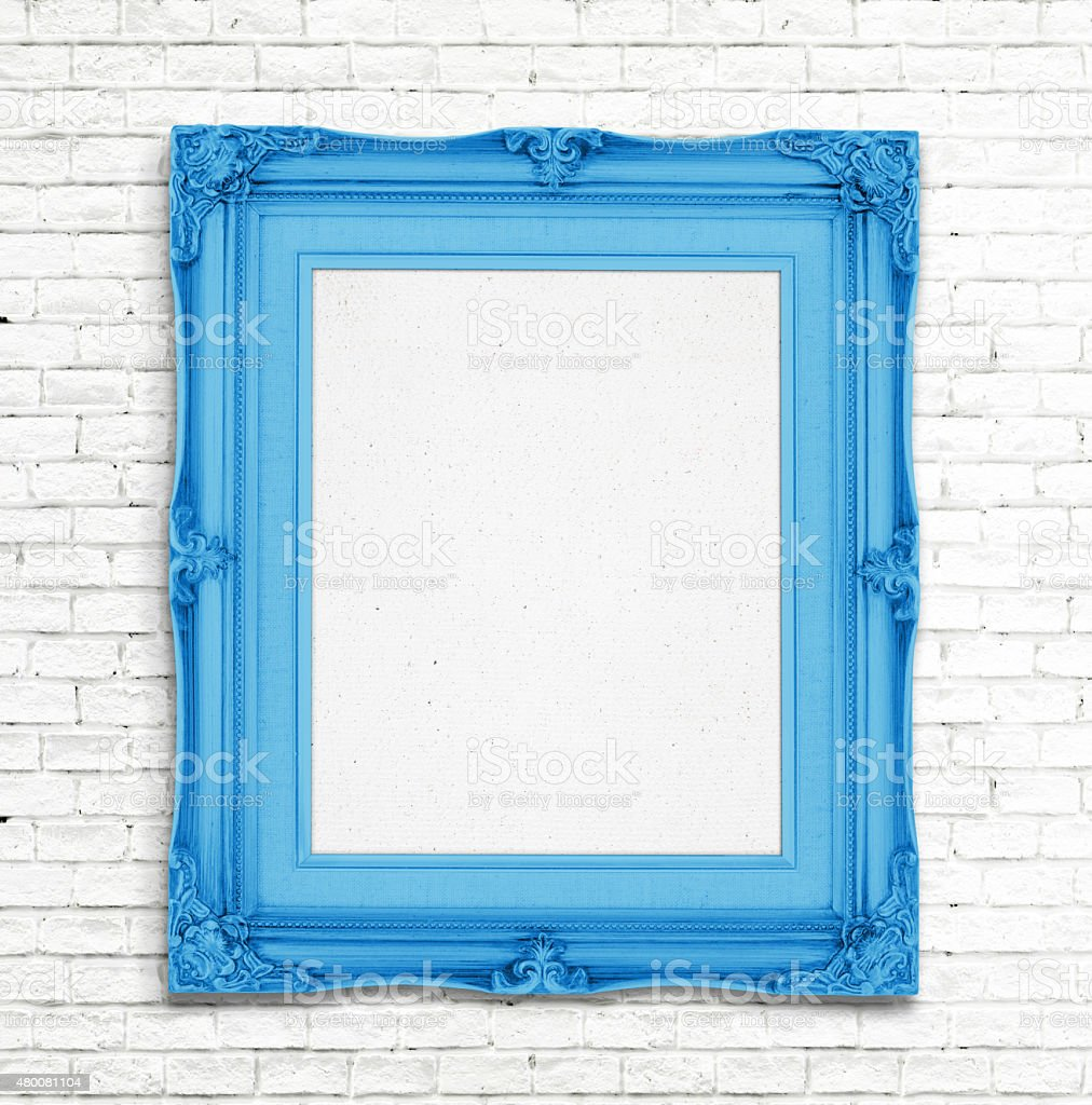 Blank blue Vintage photo frame on white brick wall stock photo