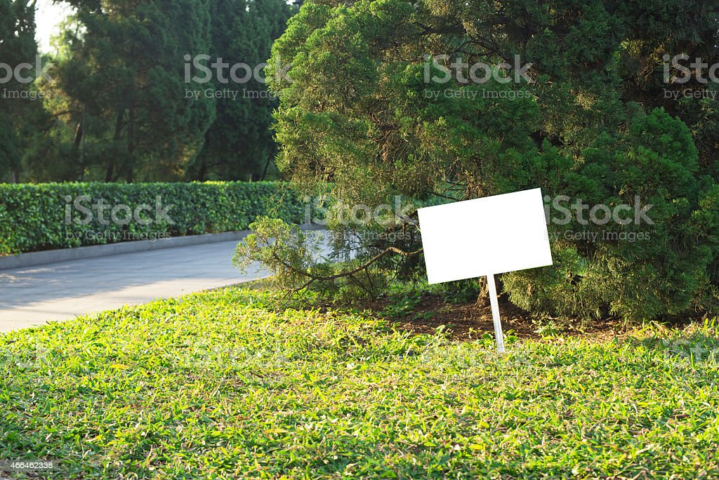 blank board on the grass stock photo