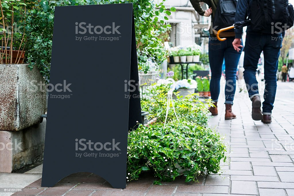Blank Board stand Black metal Signage Outdoor people walking stock photo