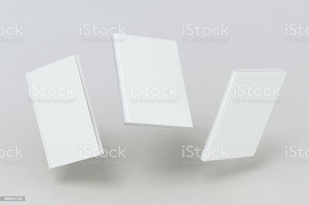 blank book cover flying stock photo