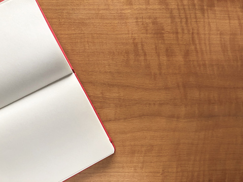 Blank book on wooden table with text space