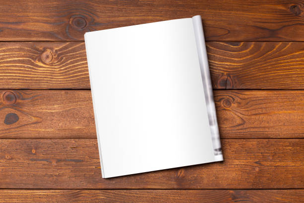 blank book or magazine cover on wood background - magazine stock photos and pictures