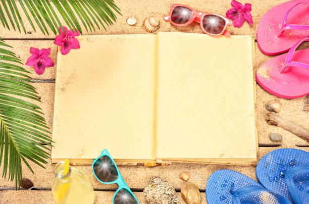 blank-buch, sand, sonnenbrille und flip flops und strand - flitterwochen flip flops stock-fotos und bilder