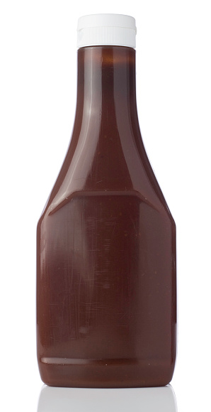 A bottle of brown Sauce bottle isolated on a white background