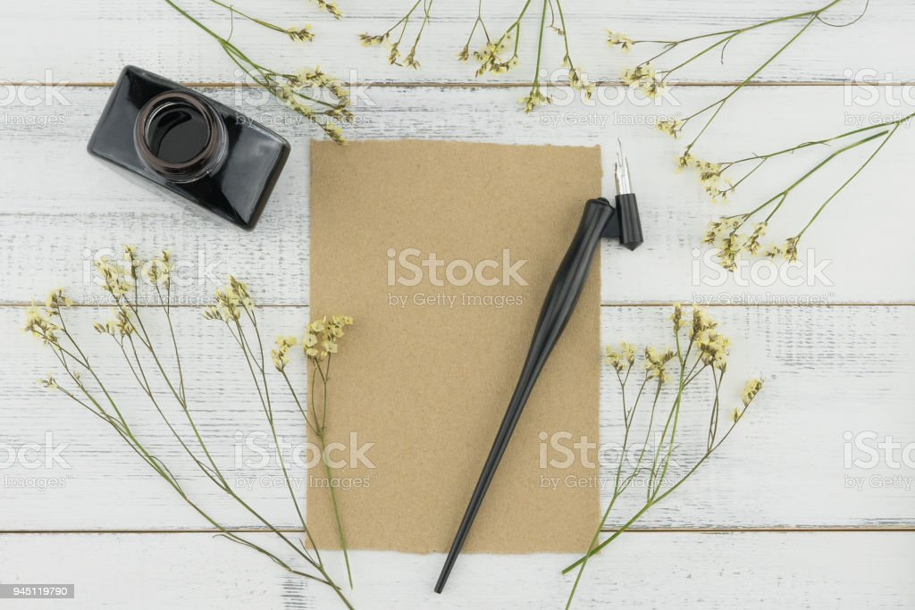 Blank brown card, oblique pen and bottle of ink stock photo