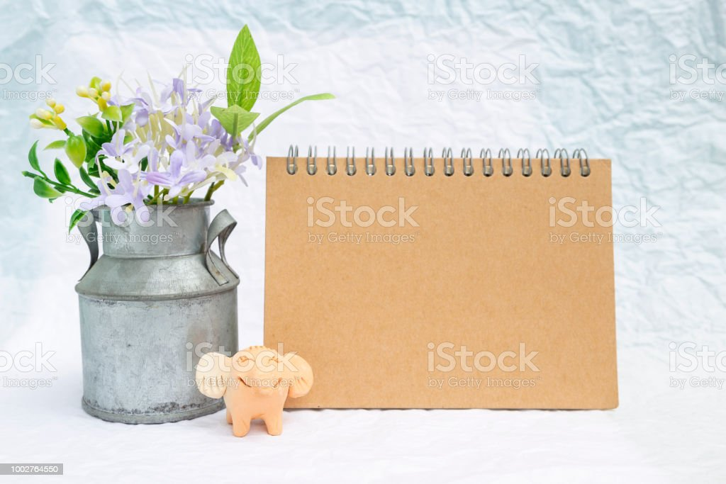 Blank Brown Card With Flower Tin Vase And Smiling Elephant Clay On