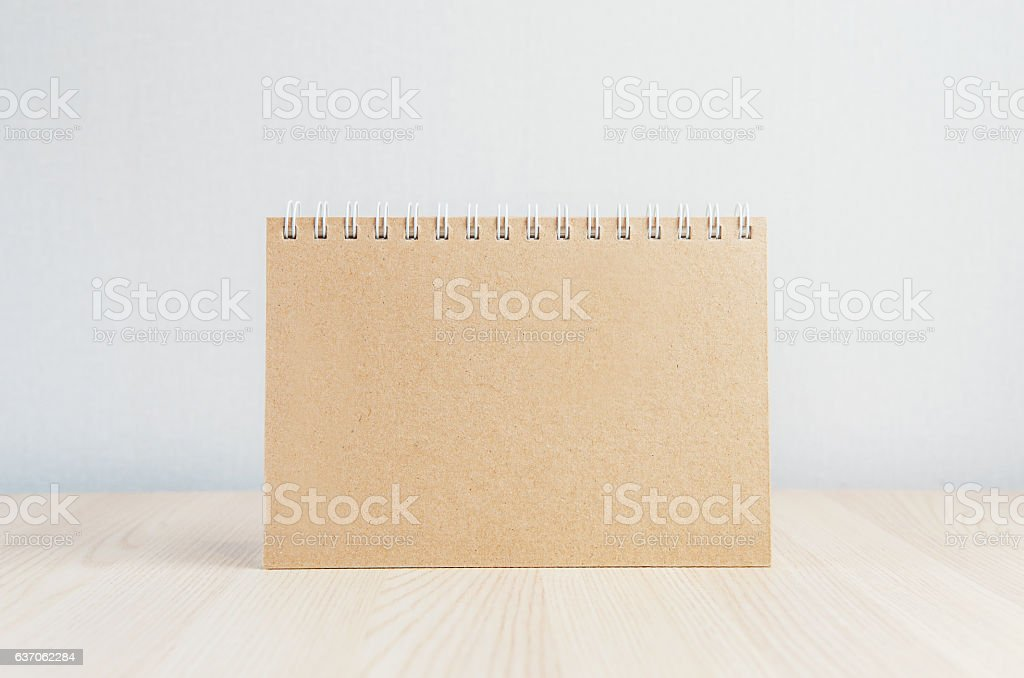 Blank brown paper on wooden table background stock photo