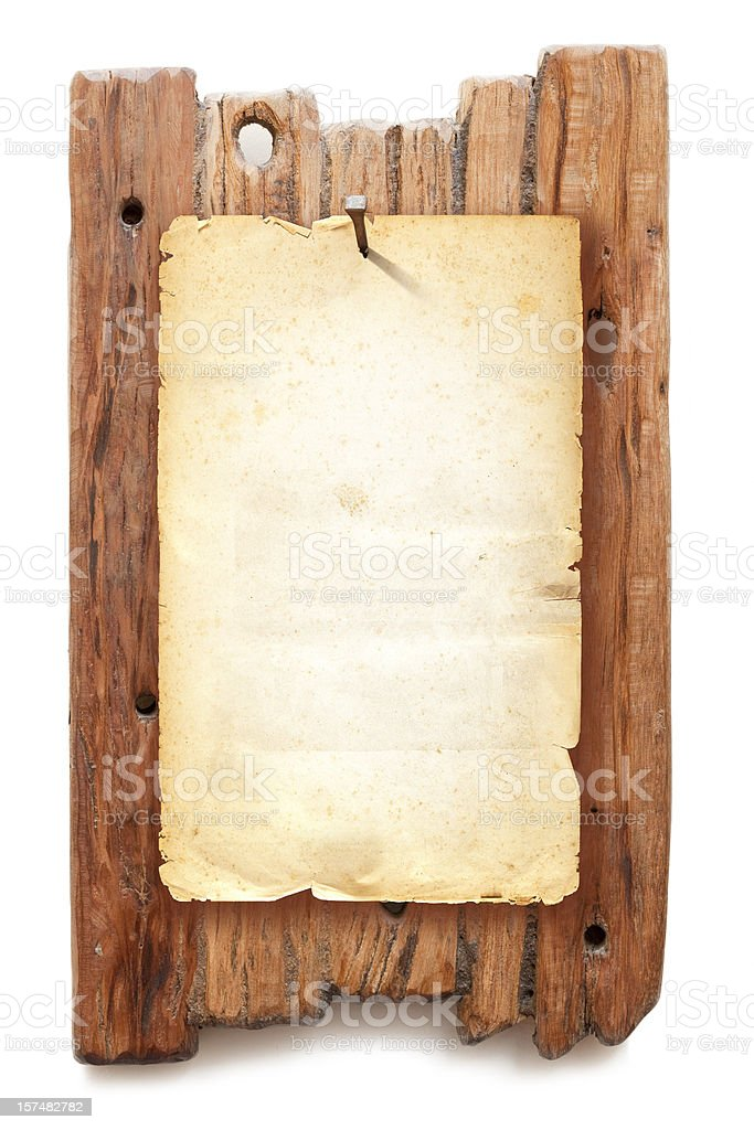 Blank brown Wanted poster fixed with nail on wooden background stock photo
