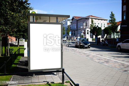istock Blank bus stop 6-sheet or billboard advertising template with copy space shot on a sunny day with blue sky 1176638647