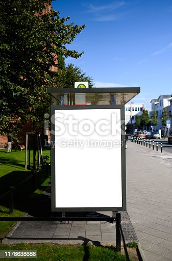 istock Blank bus stop 6-sheet or billboard advertising template with copy space shot on a sunny day with blue sky 1176638686