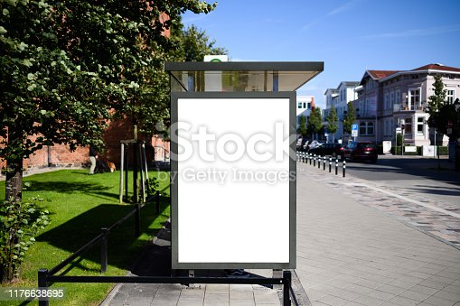 istock Blank bus stop 6-sheet or billboard advertising template with copy space shot on a sunny day with blue sky 1176638695