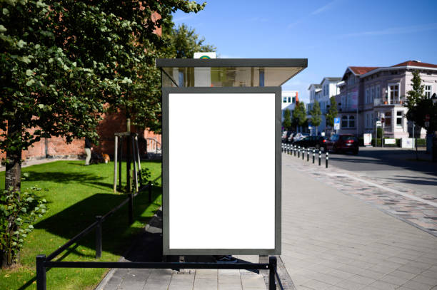 Blank bus stop 6-sheet or billboard advertising template with copy space shot on a sunny day with blue sky Blank bus stop advertising poster shot in Germany near Rostock at a bus stop. Perfect for visualising design or advertising concepts billboard stock pictures, royalty-free photos & images