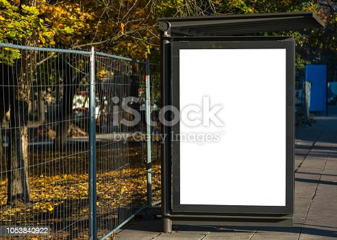Blank bus stop advertisement billboard in urban city environment. Transportation blank white isolated ad space