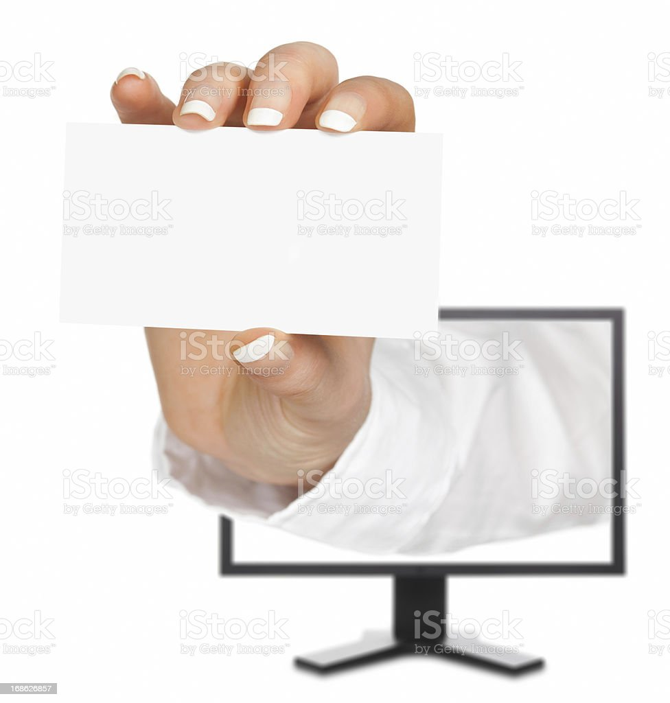 Blank business card in a hand emerges from monitor screen royalty-free stock photo