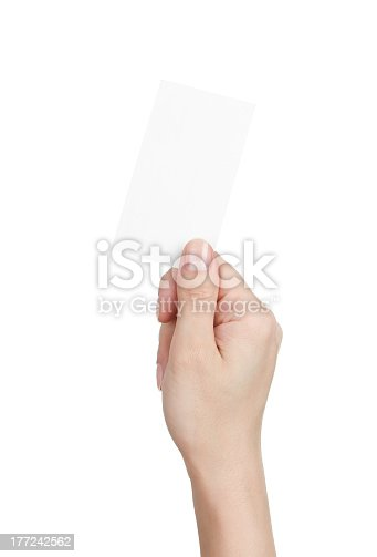 Close up of female hand holding blank business card isolated on white background