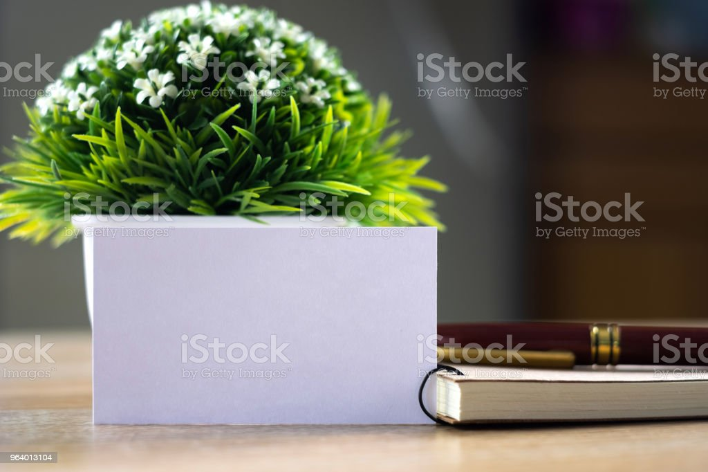 Blank business card or name card with space for add text name address and logo with notebook organizer on working table, financial company concept. - Royalty-free Advertisement Stock Photo