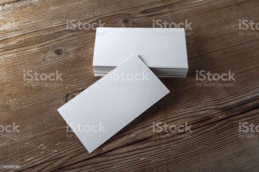 Blank business cards on a wooden desk stock photo