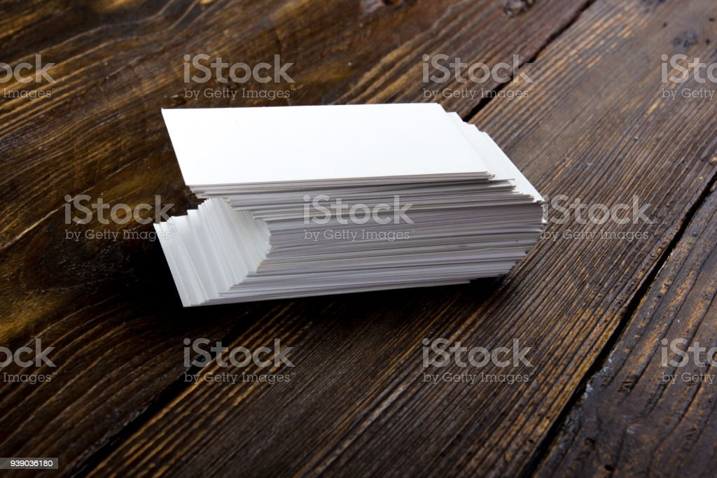 blank business cards on the wooden table template for id top view