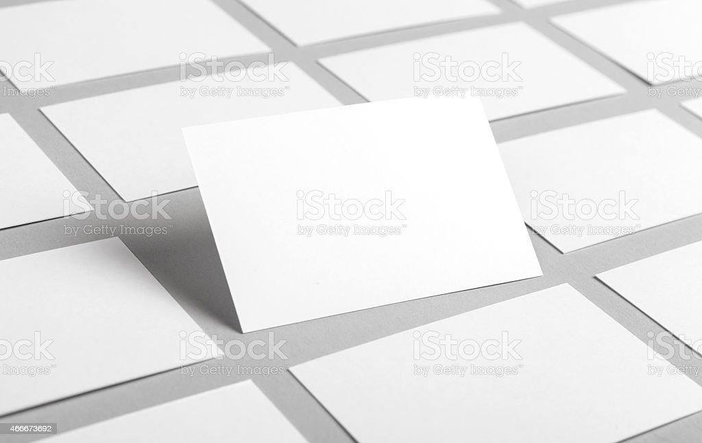 Blank business cards organized on table stock photo