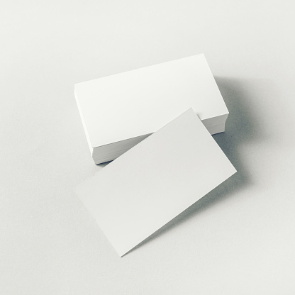 Photo of blank business cards on paper background. Mockup for ID.