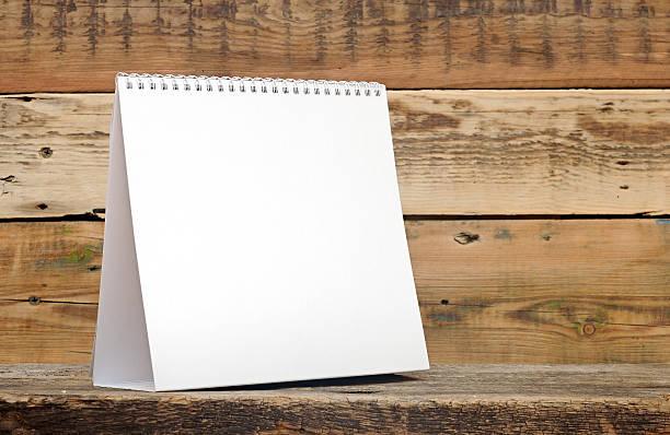 Blank calendar on wood table stock photo
