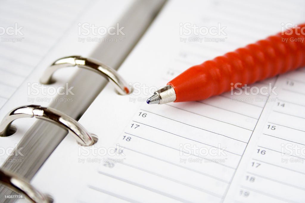 A blank calendar or planer with red pen royalty-free stock photo