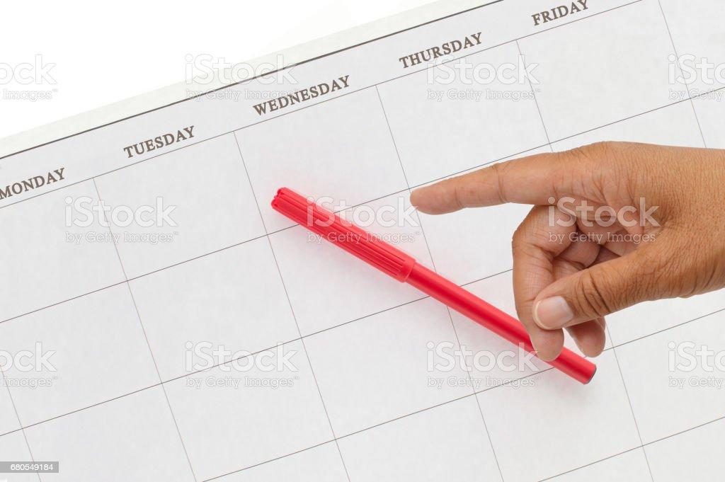 Blank Calendar Pointing finger stock photo
