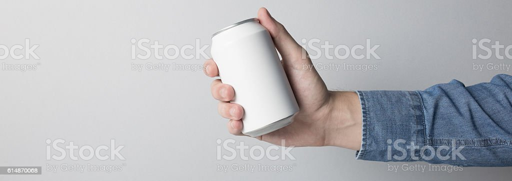 Blank Can in hand on white background stock photo