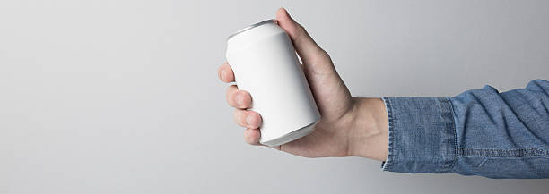 Blank Can in hand on white background - Photo