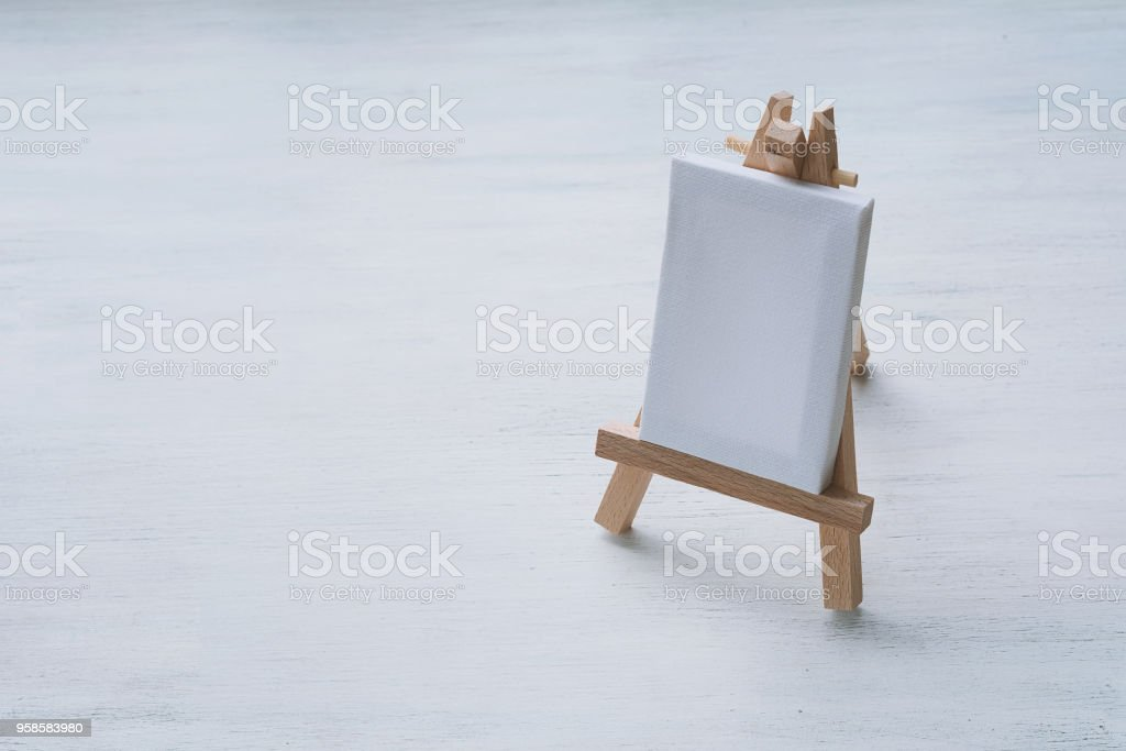Blank canvas miniature with easel stock photo