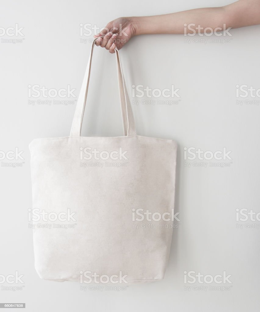 Blank canvas tote bag, design mockup with hand. Handmade shopping bags. - foto stock