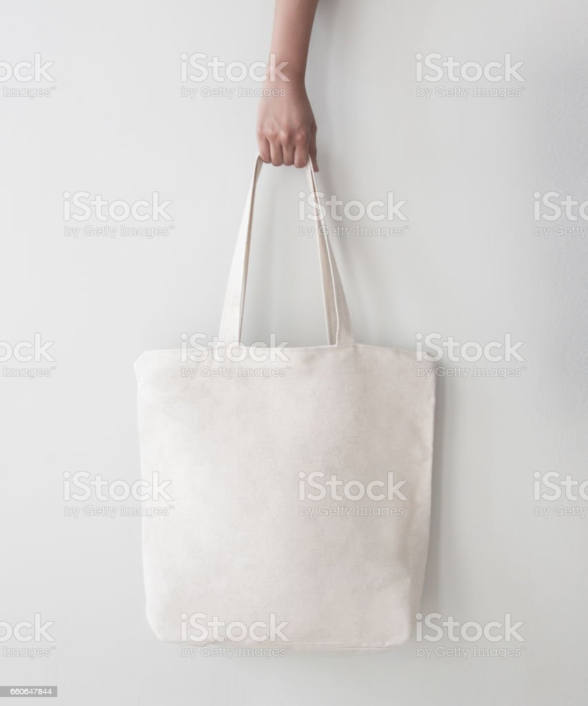 Blank canvas tote bag, design mockup with hand. Handmade shopping bags. - foto de stock