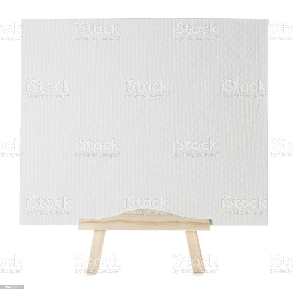 Blank canvas with wooden easel on a white background royalty-free stock photo