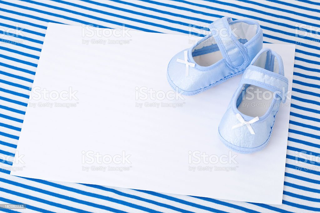 Blank card and Blue Baby Booties royalty-free stock photo