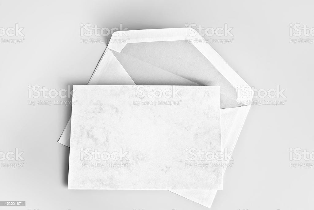 Blank card and envelope over gray background stock photo