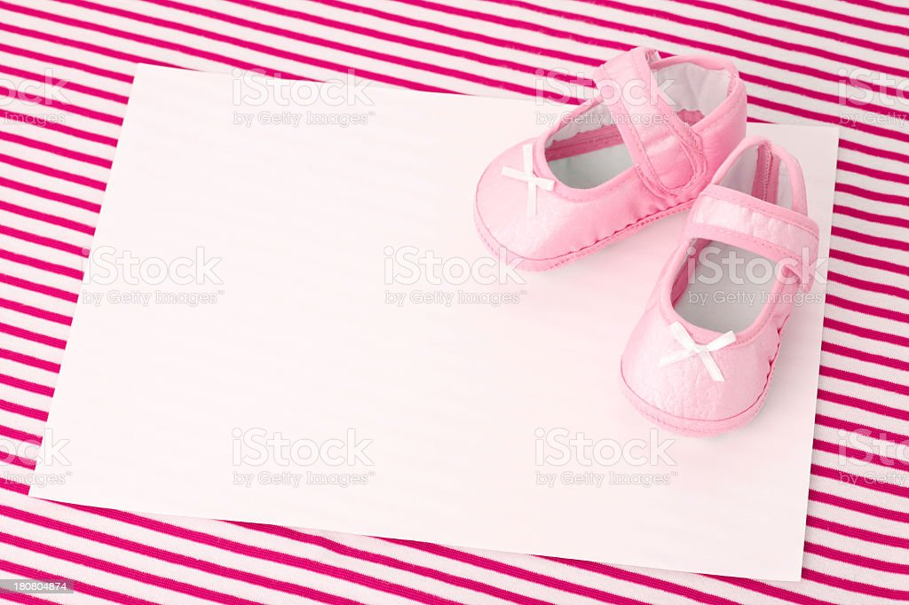 Blank card and pink Baby Booties stock photo