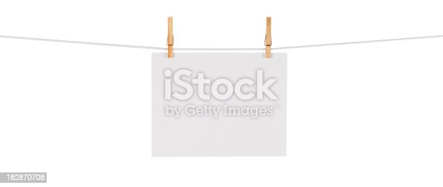 istock Blank Card Hanging on a Clothesline against White 182870708