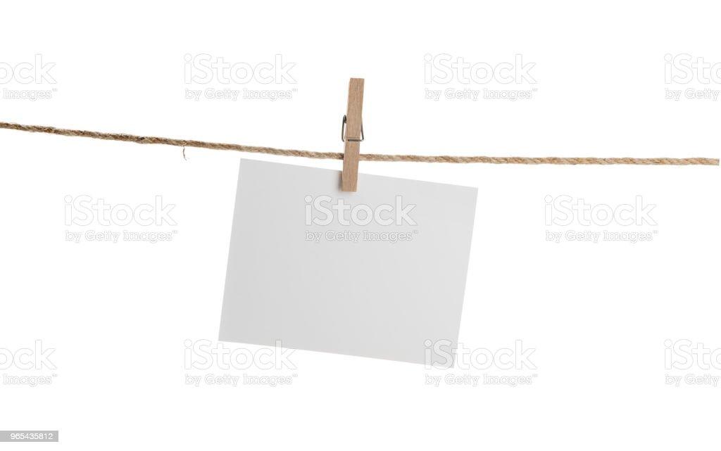 Blank Card Hanging on Clothesline Isolated zbiór zdjęć royalty-free