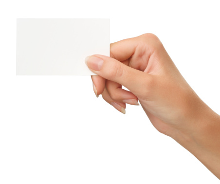 Close-up of an empty business card in a woman's hand isolated on white (+ Clipping path)