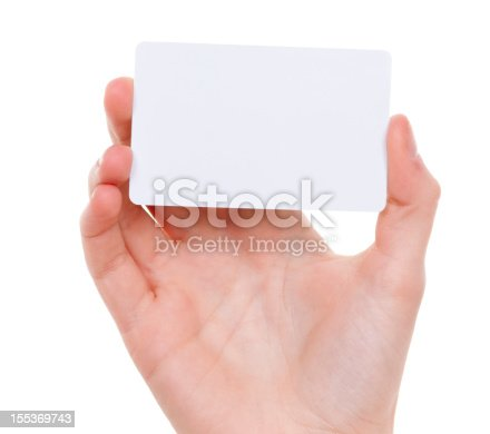 Woman`s hand holding a blank business card on white background. Close up horizontal studio shot