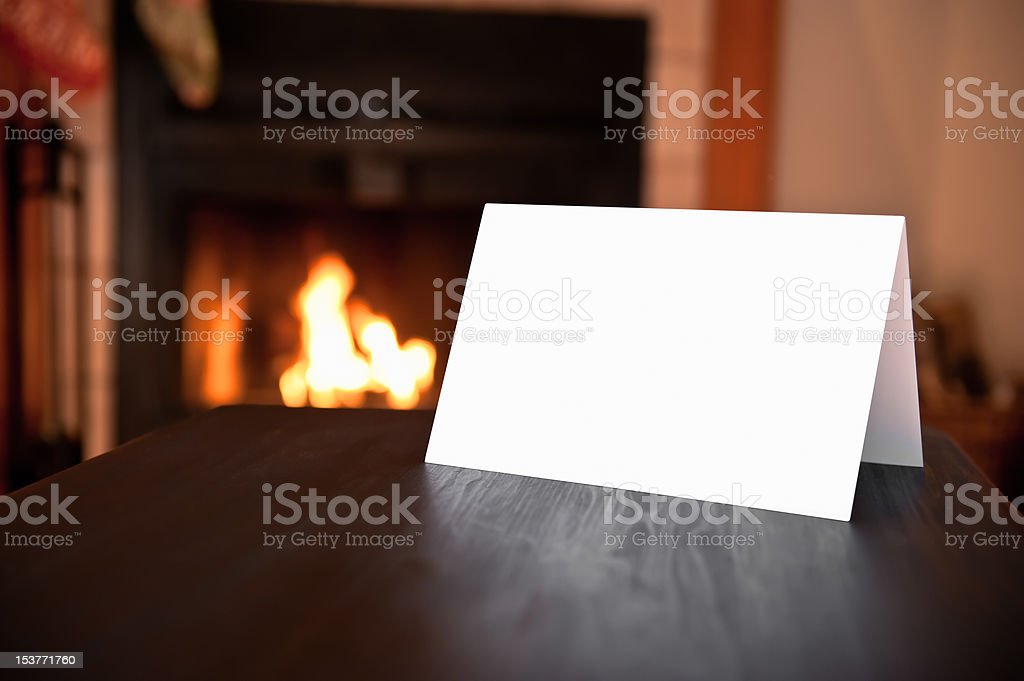 Blank Card in front of fireplace royalty-free stock photo