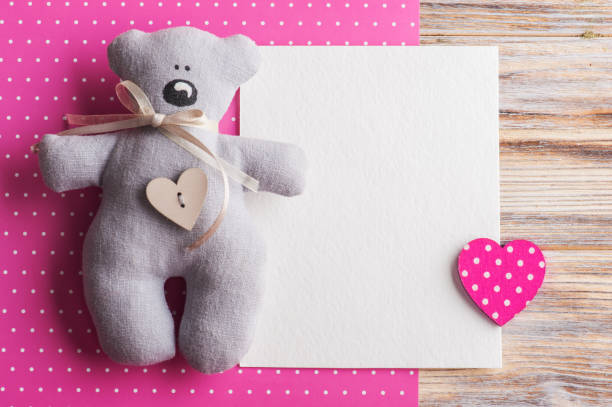 blank card on pink background with teddy bear - its a girl stock photos and pictures