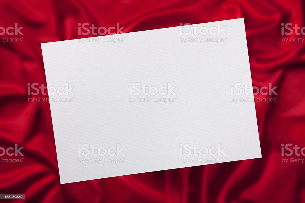 Blank card on satin background stock photo