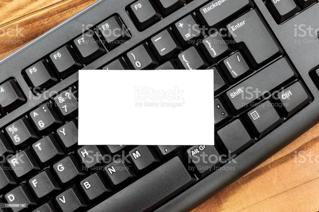 Blank card on the black keyboard. Space for text. – zdjęcie
