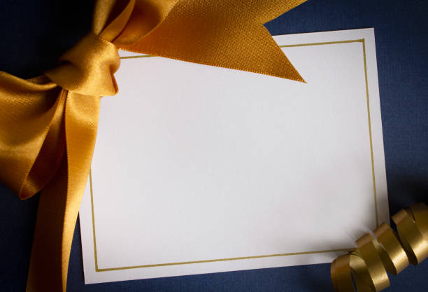 Blank card with gold ribbon stock photo