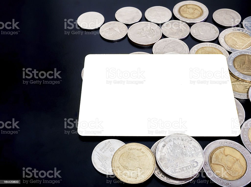 Blank card with lots of coins on black background royalty-free stock photo