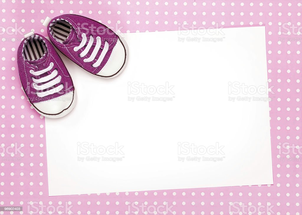 Blank card with pink baby shoes royalty-free stock photo