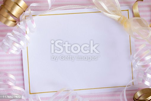 875685464istockphoto Blank card with ribbons and pink stripes 1176527822