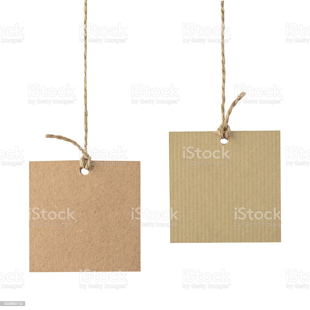 Blank cardboard labels tied with rope isolated. stock photo
