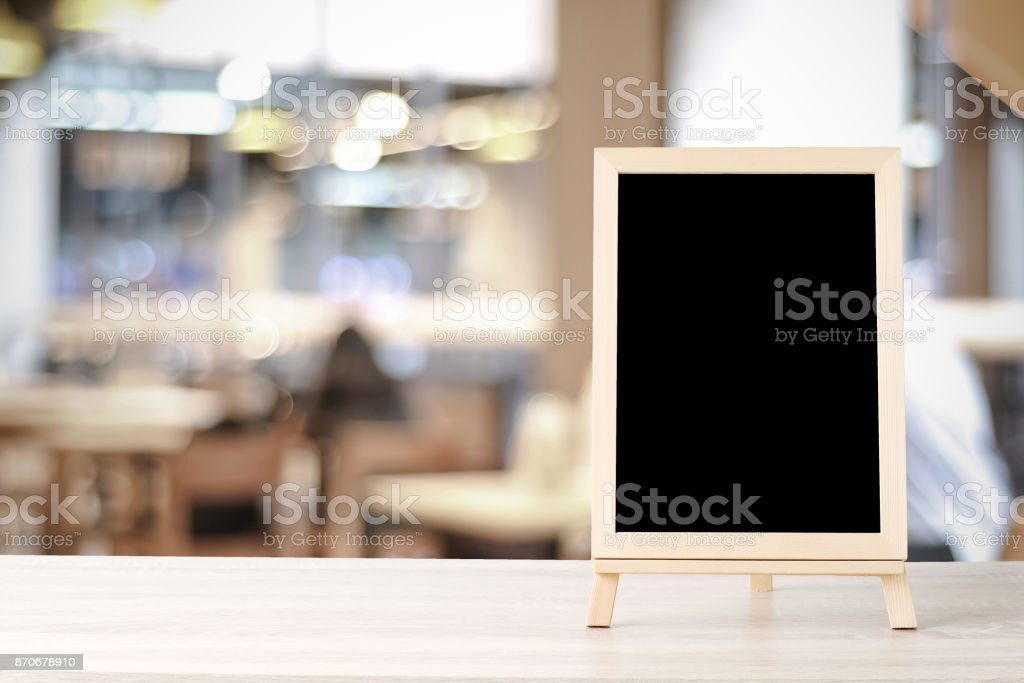 Blank Chalkboard Standing On Wood Table Over Blur Restaurant With - Standing table for restaurant
